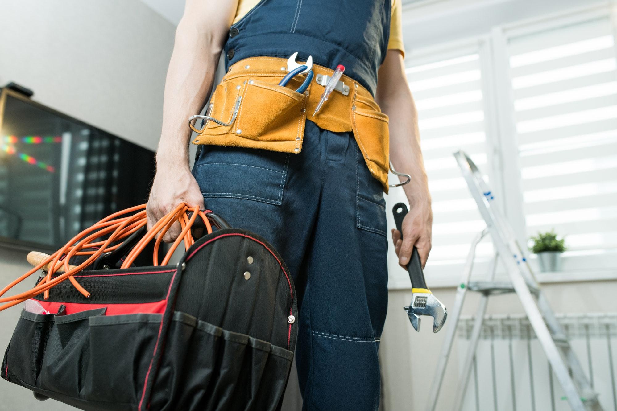 Handyman with bag of work tools